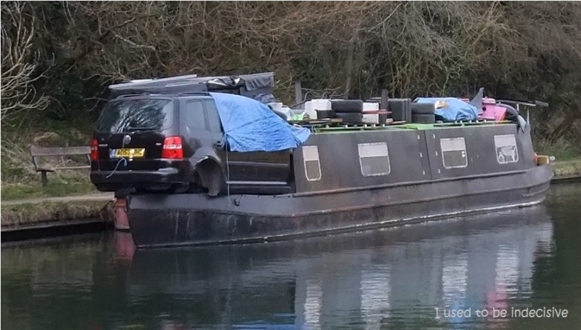 car on canal boat 2